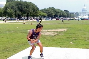 Steve Mercado plays stickball on the National Mall, 2001